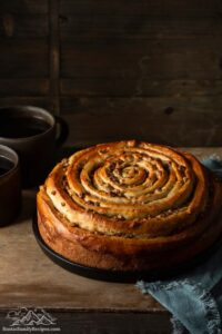 Spiral coffee cake in springform pan after sides are removed